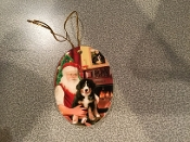 Santa sitting with a Berner Ornament